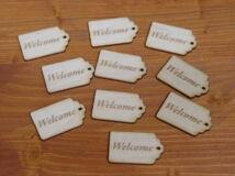 """Natúr fa - """"Welcome"""" gravírozott scrapbook táblák 3x4,5cm 10db/csomag"""